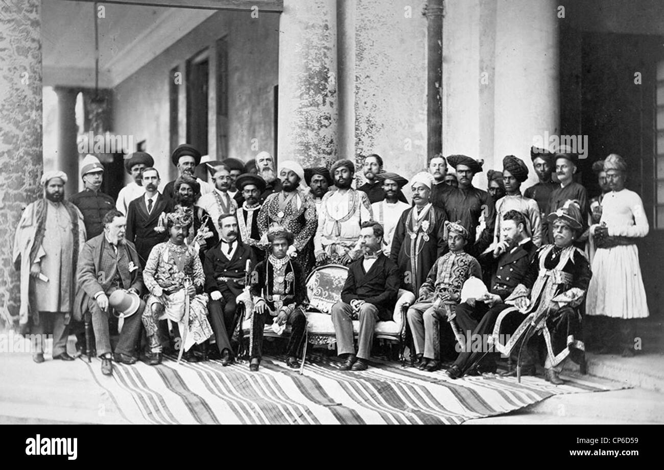 SIR RICHARD TEMPLE (1826-1902) British Indian administrator centre right with young Gaewark of Baroda to his right - Stock Image