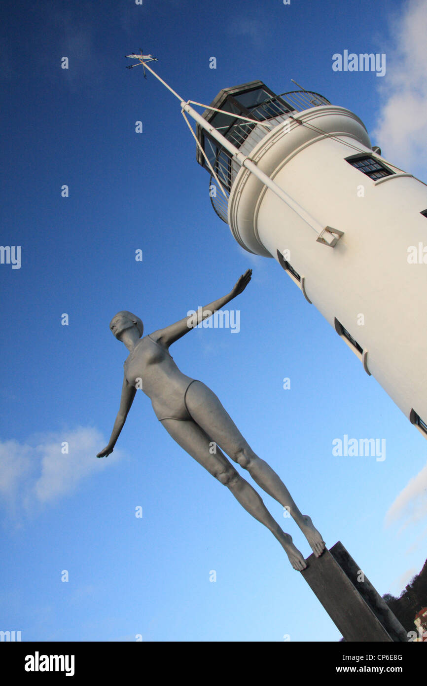 The 'Diving Belle' sculpture by the lighthouse on Scarborough Harbour, Scarborough, North Yorkshire, UK - Stock Image