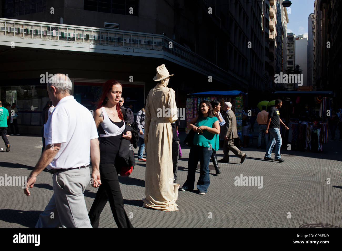 Living statue downtown Sao Paulo Brazil Mime artist posing for hours in street like a statue with realistic statue - Stock Image