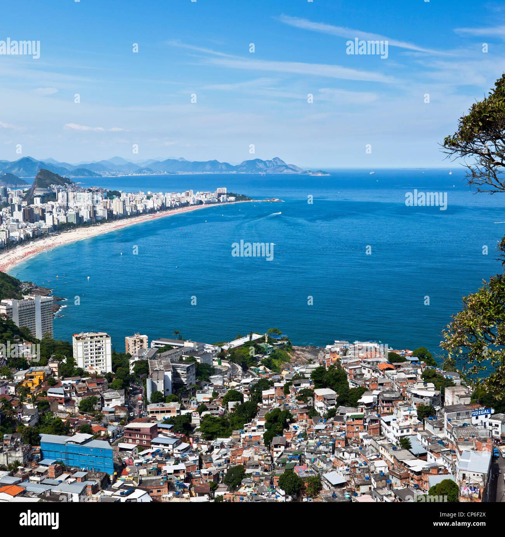 Dwelling conditions at Favela do Vidigal, Rio de Janeiro, Brazil. Ipanema and Leblon beaches in background fantastic - Stock Image