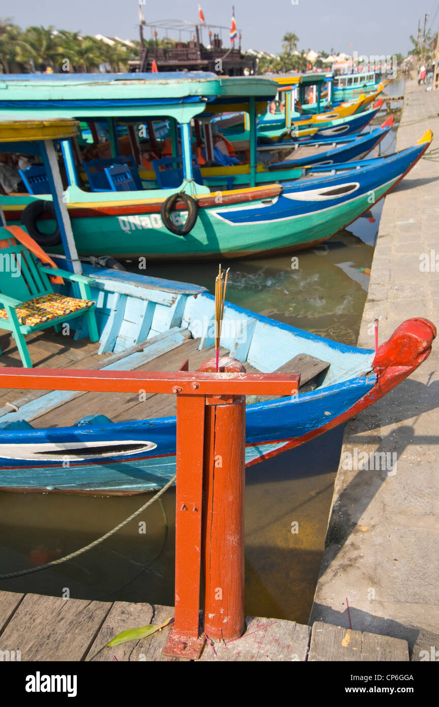 Horizontal close up of eyes painted on the bows of tourist boats and