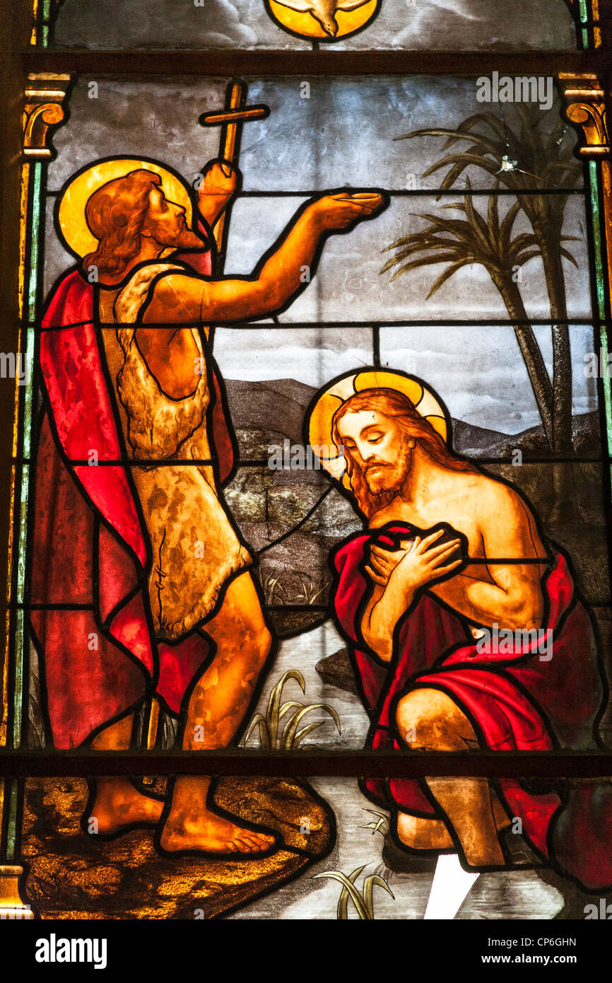 Baptism of Jesus by John the Baptist stained glass window, Notre Dame Cathedral, Ho Chi Minh City, (Saigon), Vietnam Stock Photo