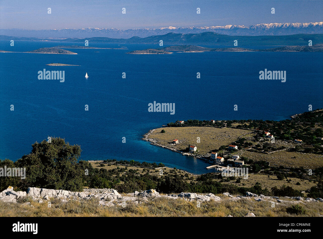 Croatia - Dalmatia - Island Zut - Bizikovicanel Adriatic sea with some islands and Velebit mountains in the background - Stock Image