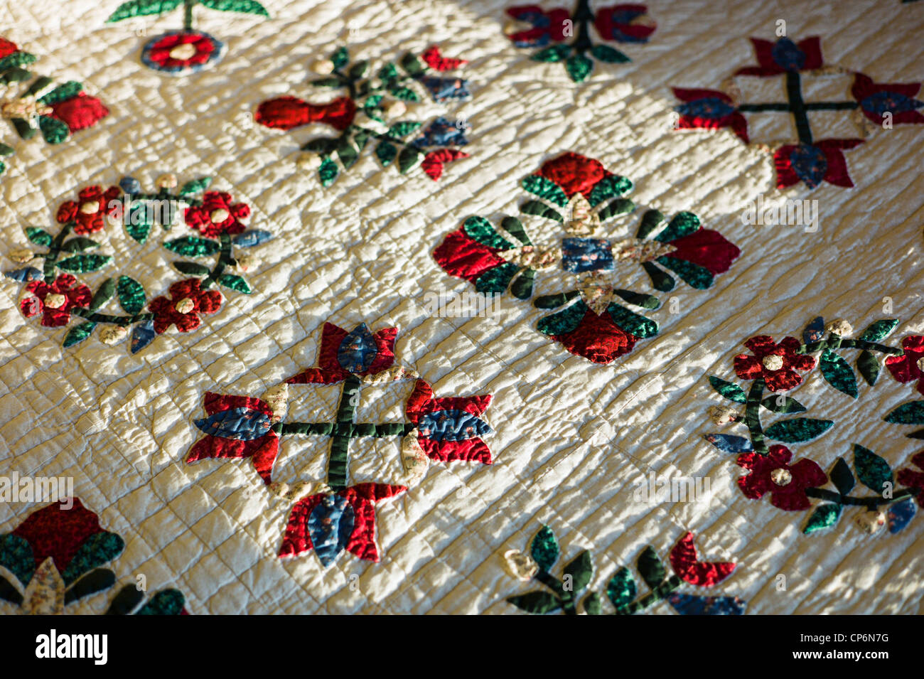 Close up detail of handmade bed quilt - Stock Image