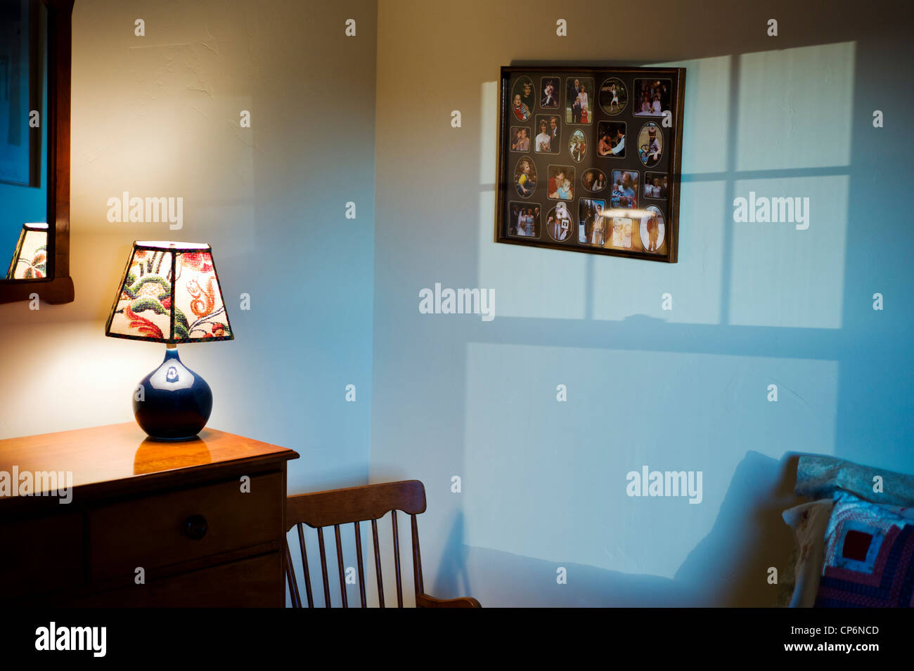 Framed montage of family heirloom photographs hanging on the wall of a private residence. - Stock Image
