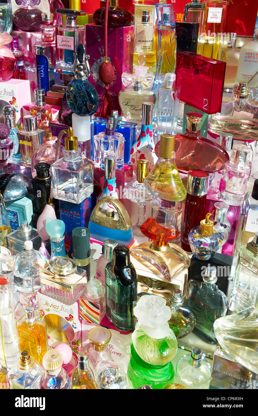 Bottles of counterfeit perfume bottles on display by a street vendor in Korea - Stock Image