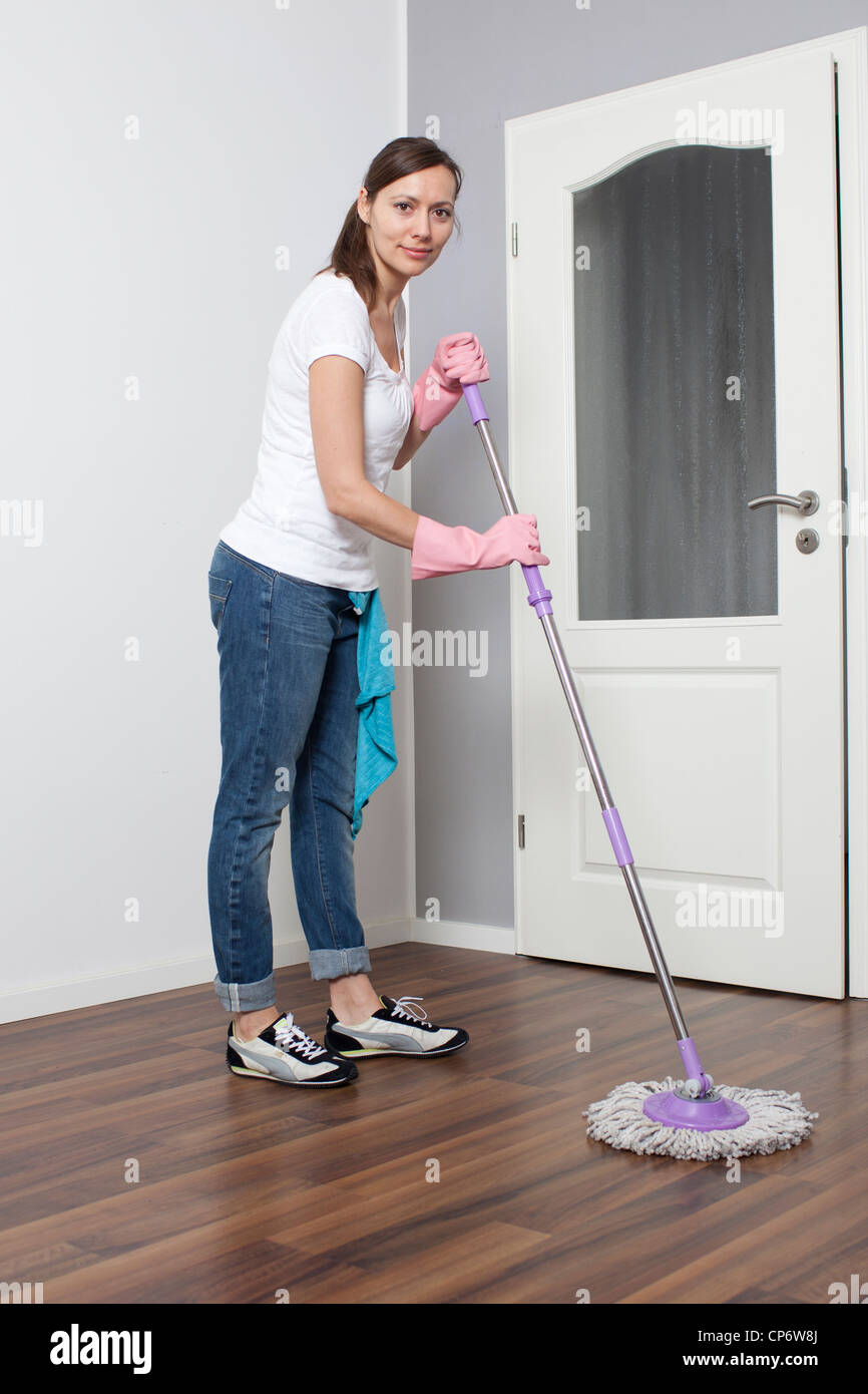 Woman cleaning the flat - Stock Image