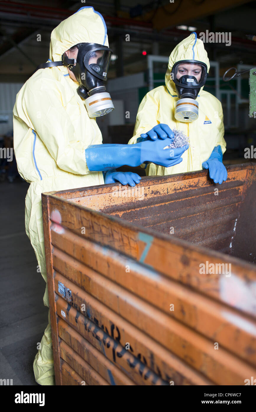 Experts analyzing infested material - Stock Image
