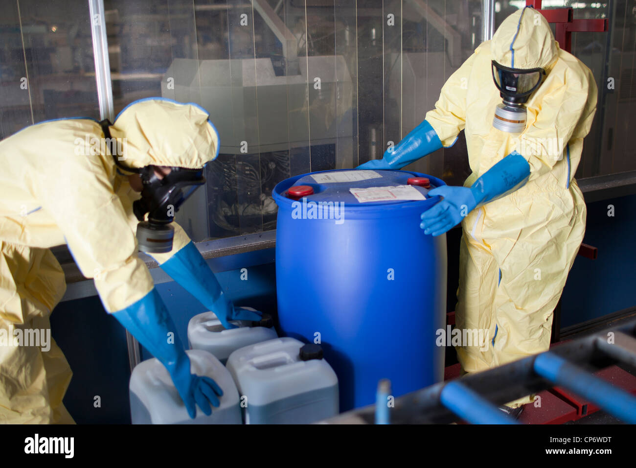 Experts disposing infested material - Stock Image