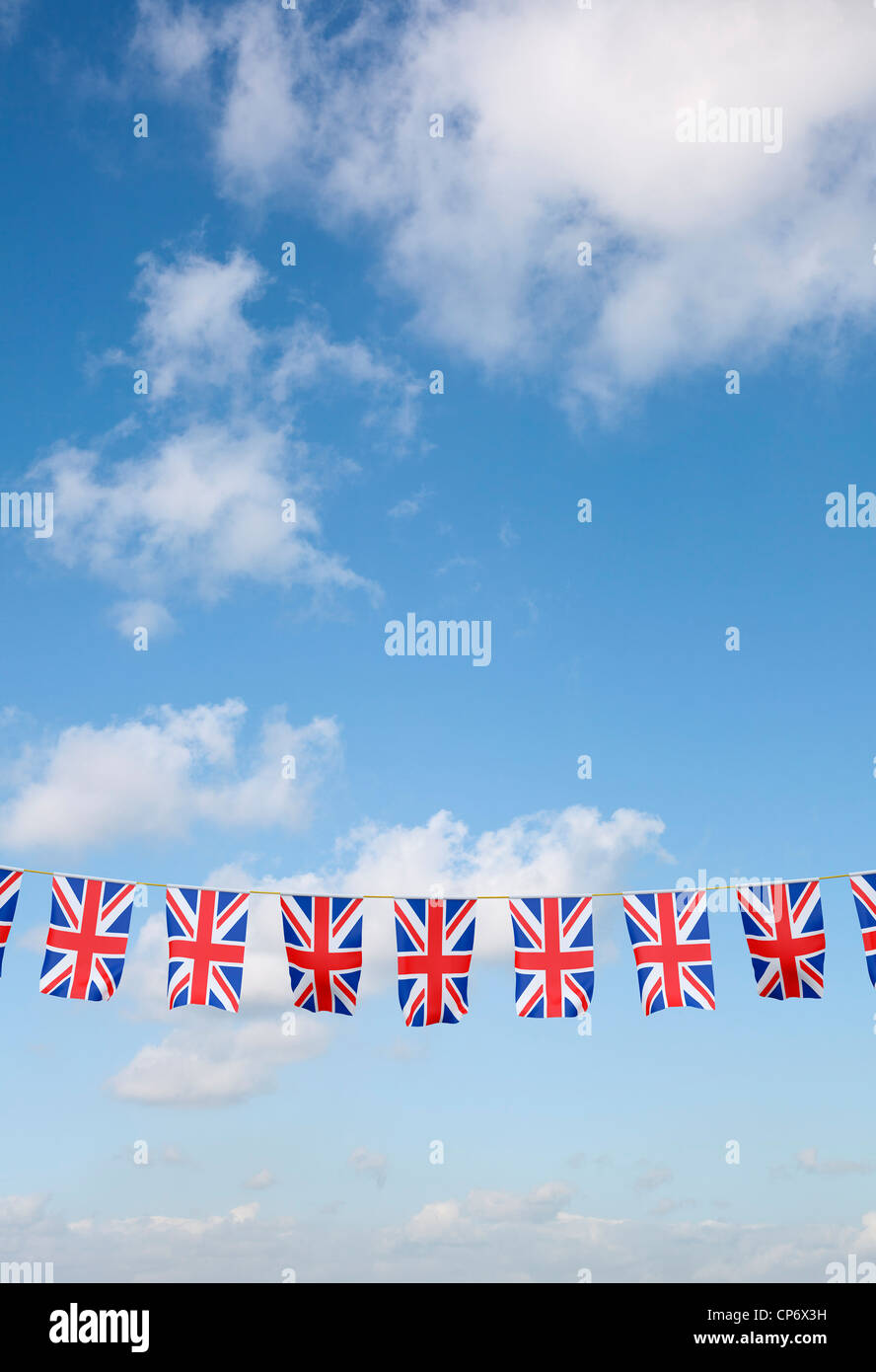 Bunting with Union Jack UK flag against blue sky - Stock Image