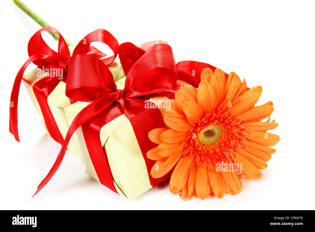 Little Gifts with Red Bows and Gerbera Flower - Stock Image
