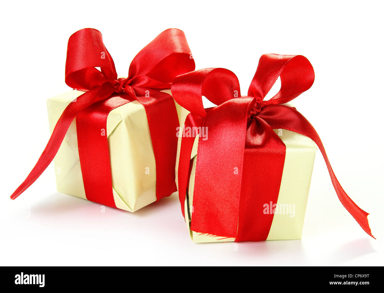 Two Nice Little Gifts with Red Bows - Stock Image