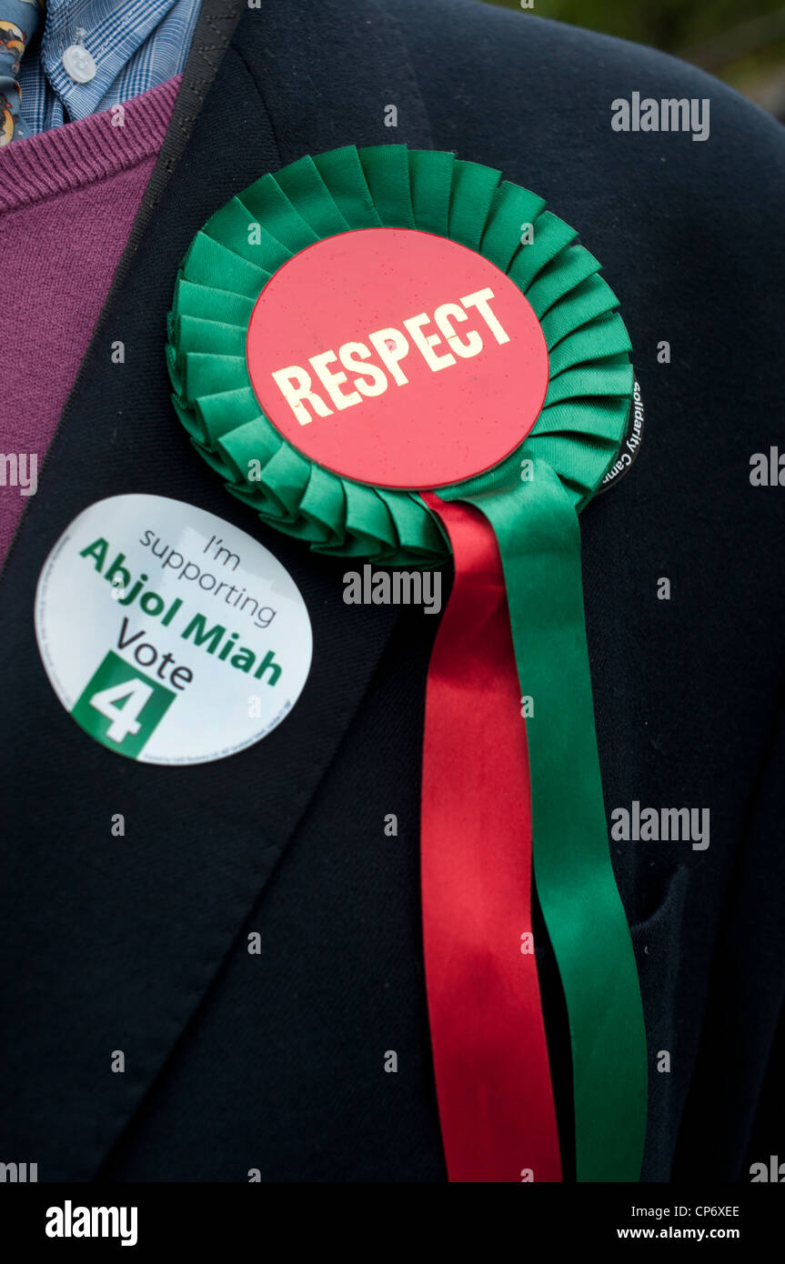 May3rd 2012 London election. Columbia Road polling centre.Man wearing Respect party rosette with badge for Abjol - Stock Image