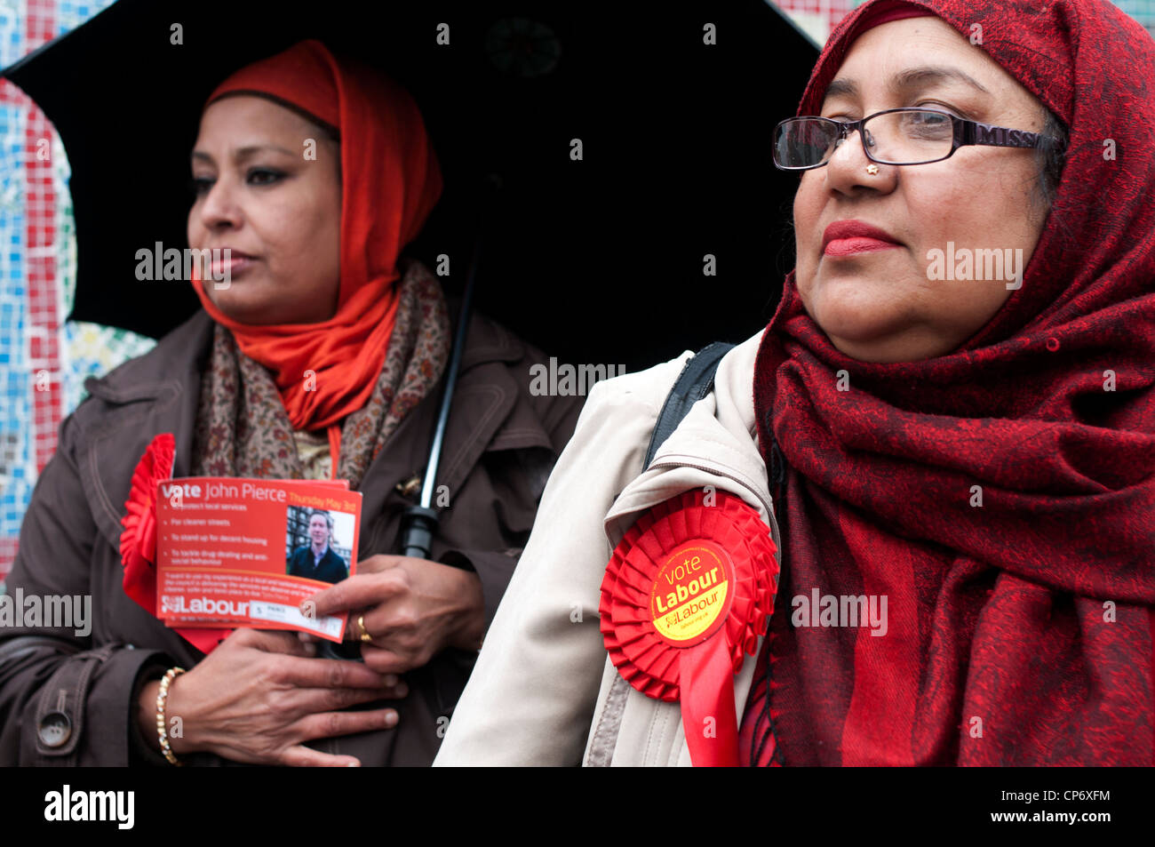 May3rd 2012 London election. Columbia Road polling centre. Two Asian women from Bangladeshi community with labour - Stock Image