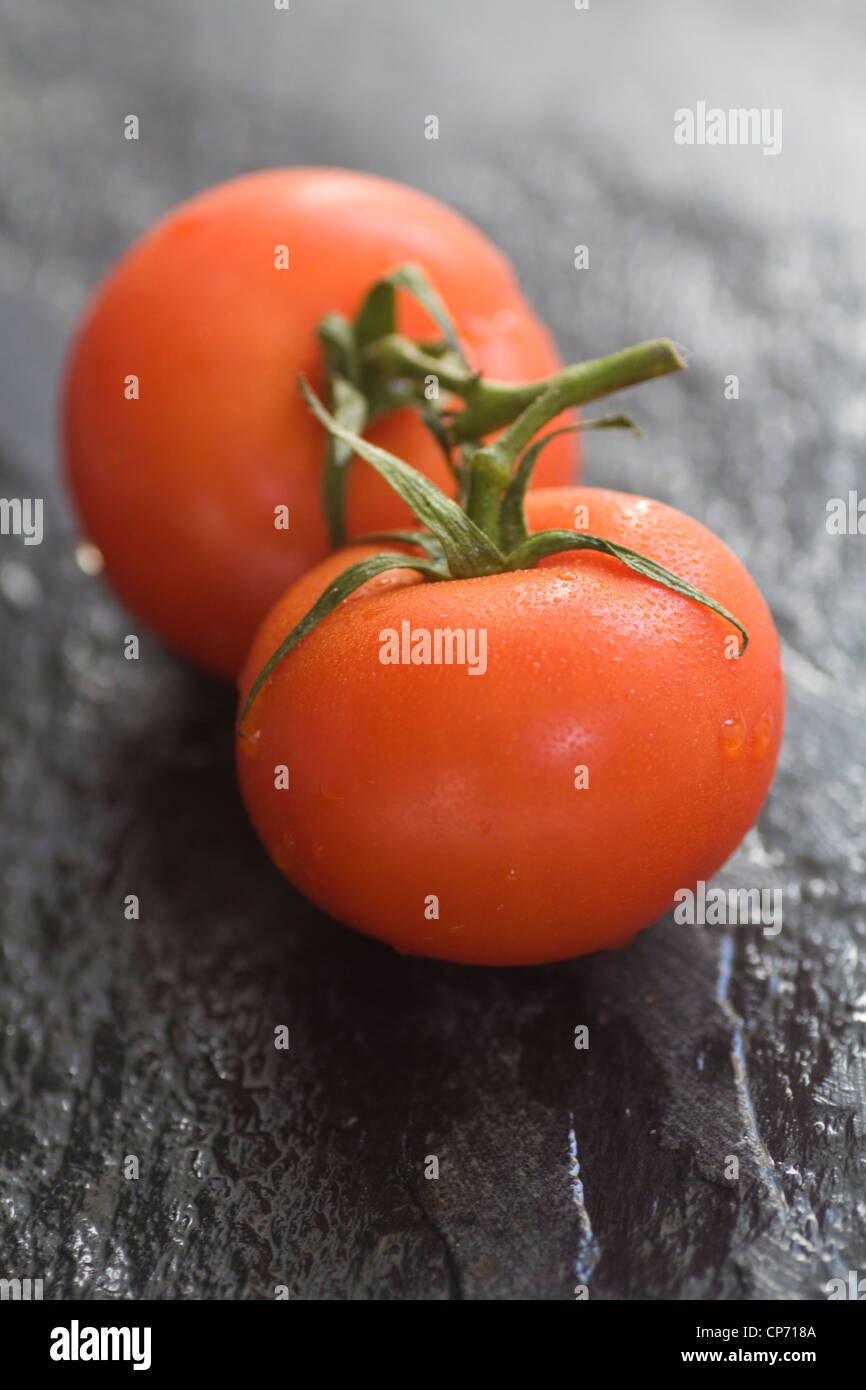 A photograph of some fresh red vine tomatoes - Stock Image
