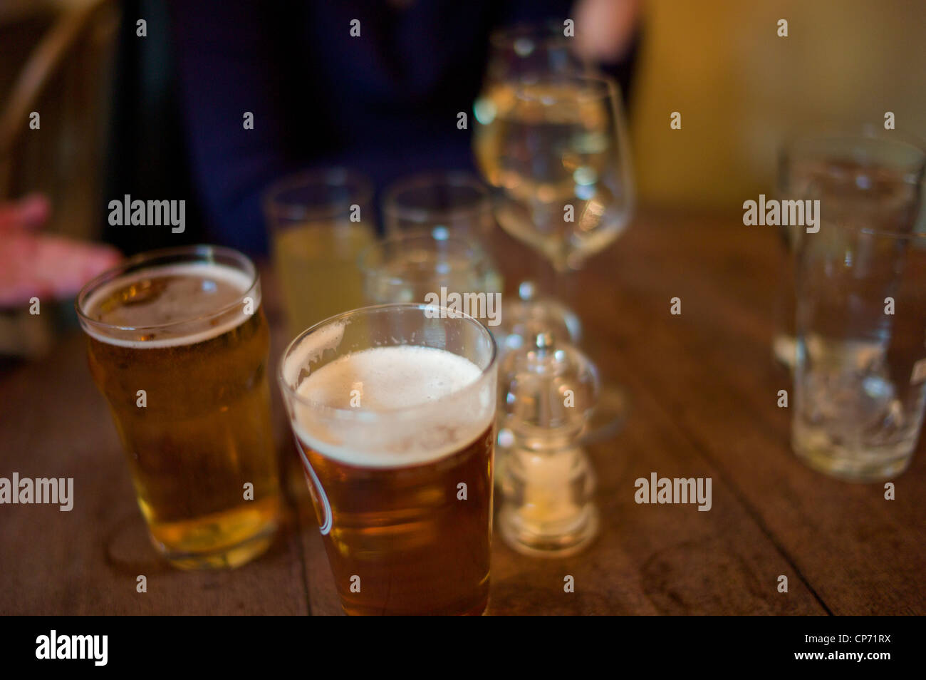 Table in a pub with drinks blurred - Stock Image