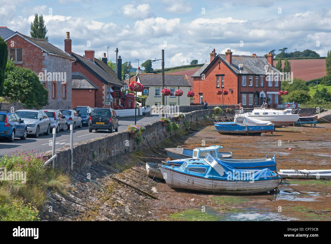 Boats in the harbour at low tide in the small village of Cockwood near Dawlish Warren, East Devon, south west England, - Stock Image