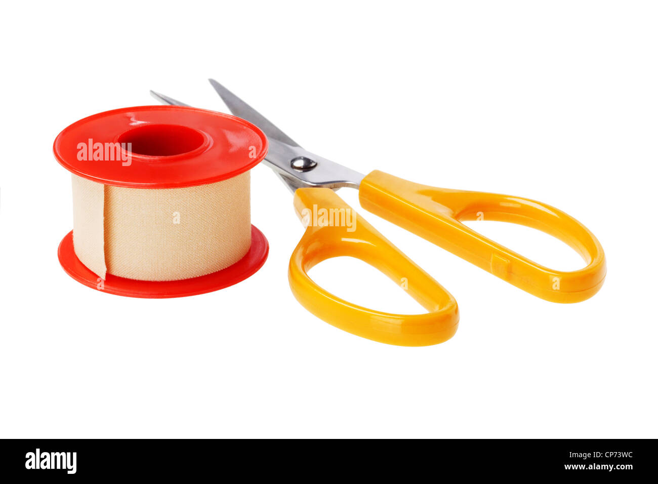 Roll of Medical Sticking Plaster and cutting scissors on White Background - Stock Image