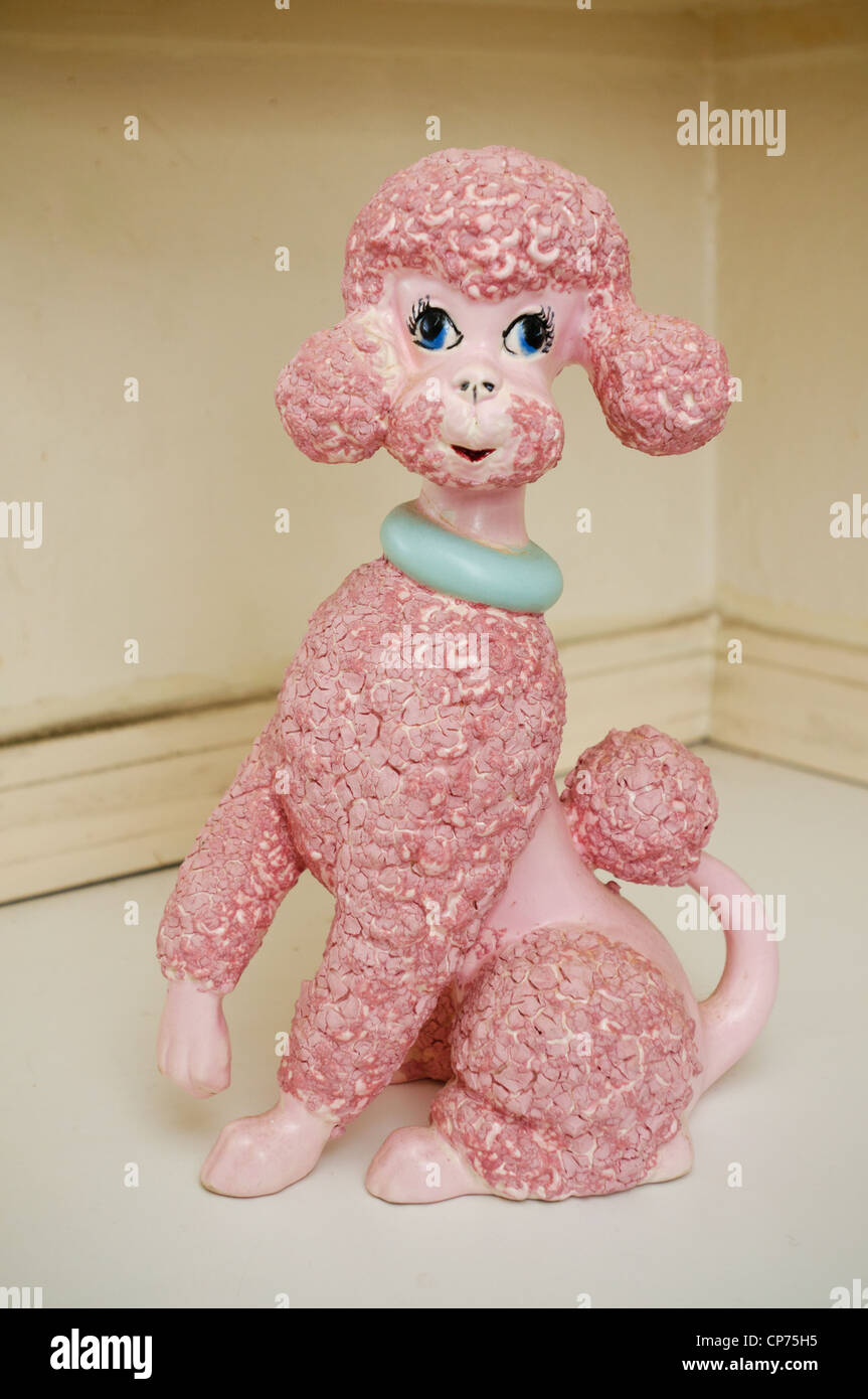 A pink, ceramic poodle. - Stock Image