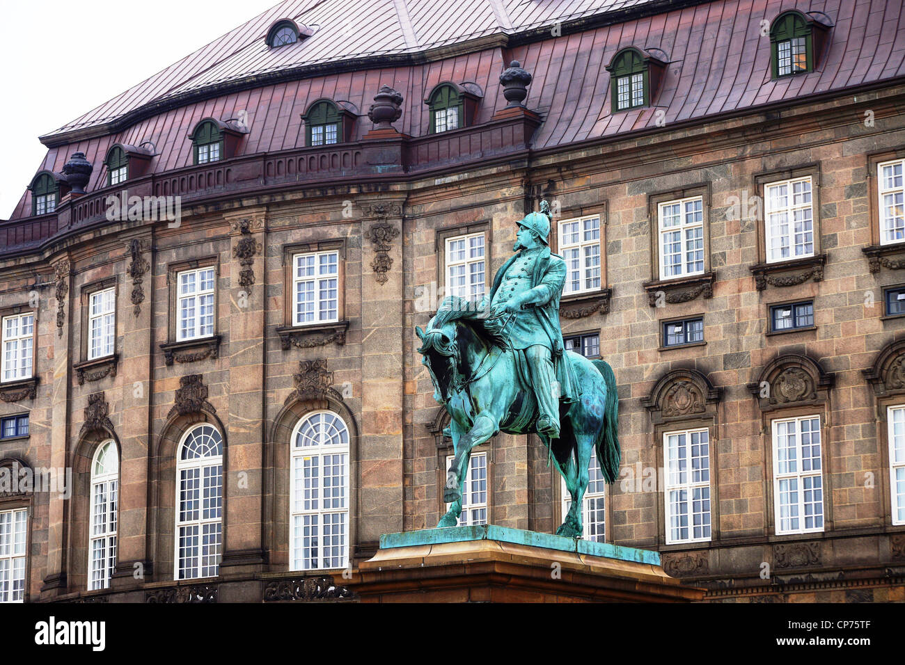 The statue of King Christian IV stands proudly in splendour outside the Christiansborg Palace in Copenhagen Denmark - Stock Image