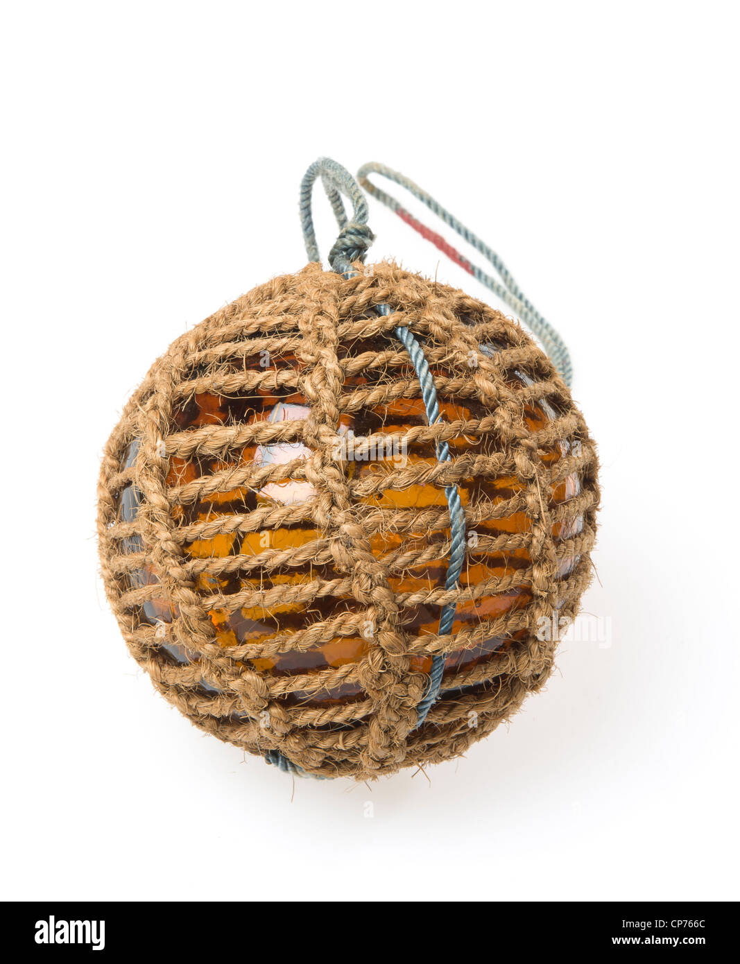 Glass fishing buoy used to keep fishing nets floating. This is an old glass antique. Isolated on white background. - Stock Image