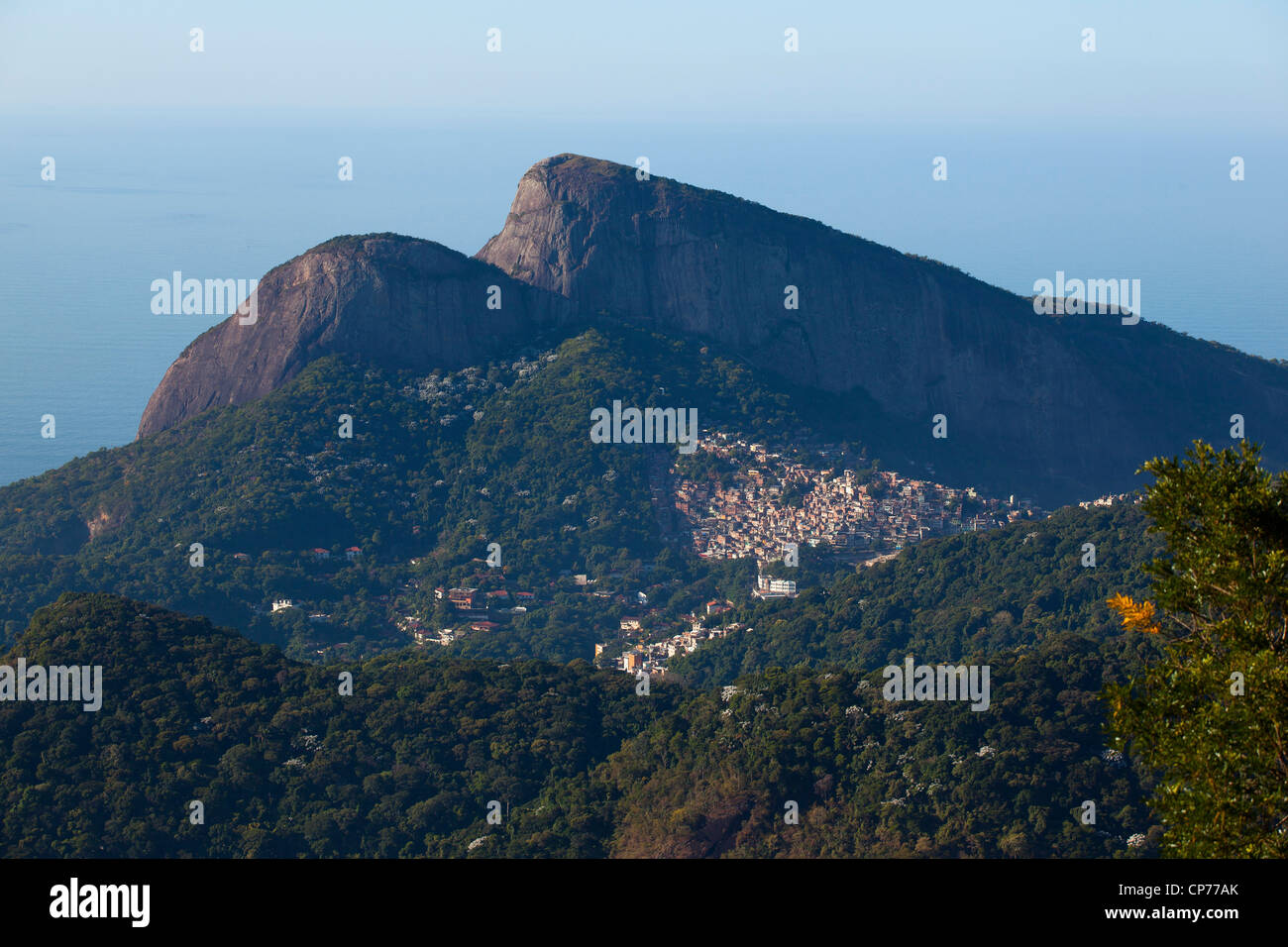 Favela do Vidigal inside Atlantic Forest Morro Dois Irmaos Rio de Janeiro, Brazil. Urban land occupation - Stock Image