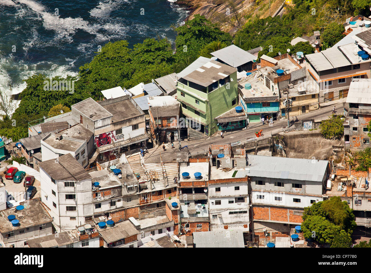 Dwelling condition Favela do Vidigal Rio de Janeiro Brazil Lots domestic satellite TV receiving dishes & water - Stock Image