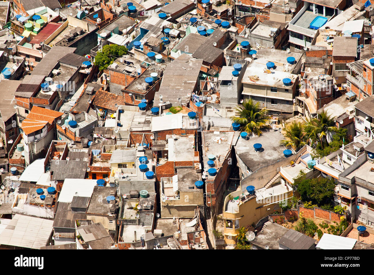 Dwelling conditions Favela do Vidigal Rio de Janeiro Brazil Lots domestic satellite TV receiving dishes & water - Stock Image