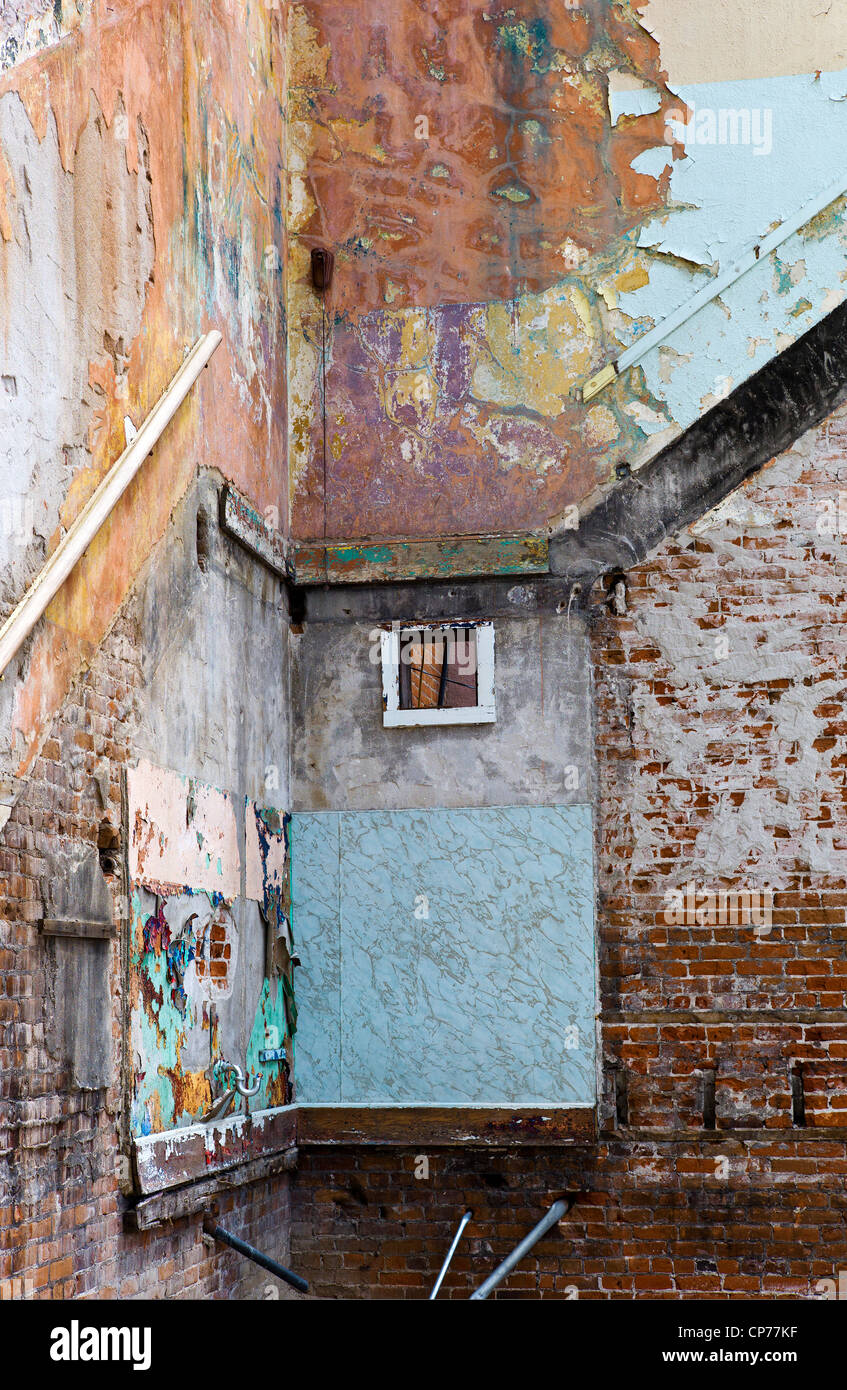 Interior walls and structure of the historic Unique Theater are exposed in partial decay, Salida, Colorado, USA - Stock Image