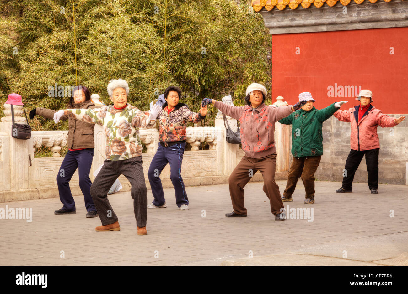 Group of women performing tai chi or taiji outdoors at Jingshan Park, Beijing. - Stock Image