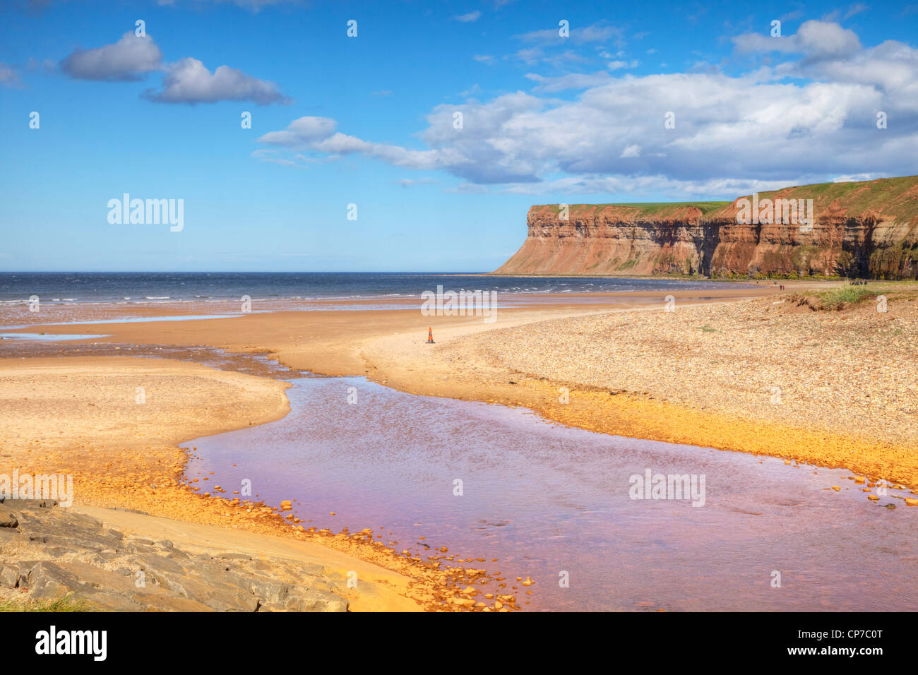 The beach at Saltburn-by-the-Sea and Huntcliff. - Stock Image