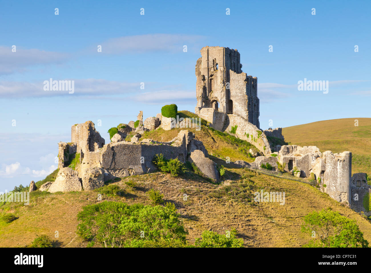 Corfe Castle on its hill above the beautiful Dorset countryside, on a lovely summer afternoon. - Stock Image