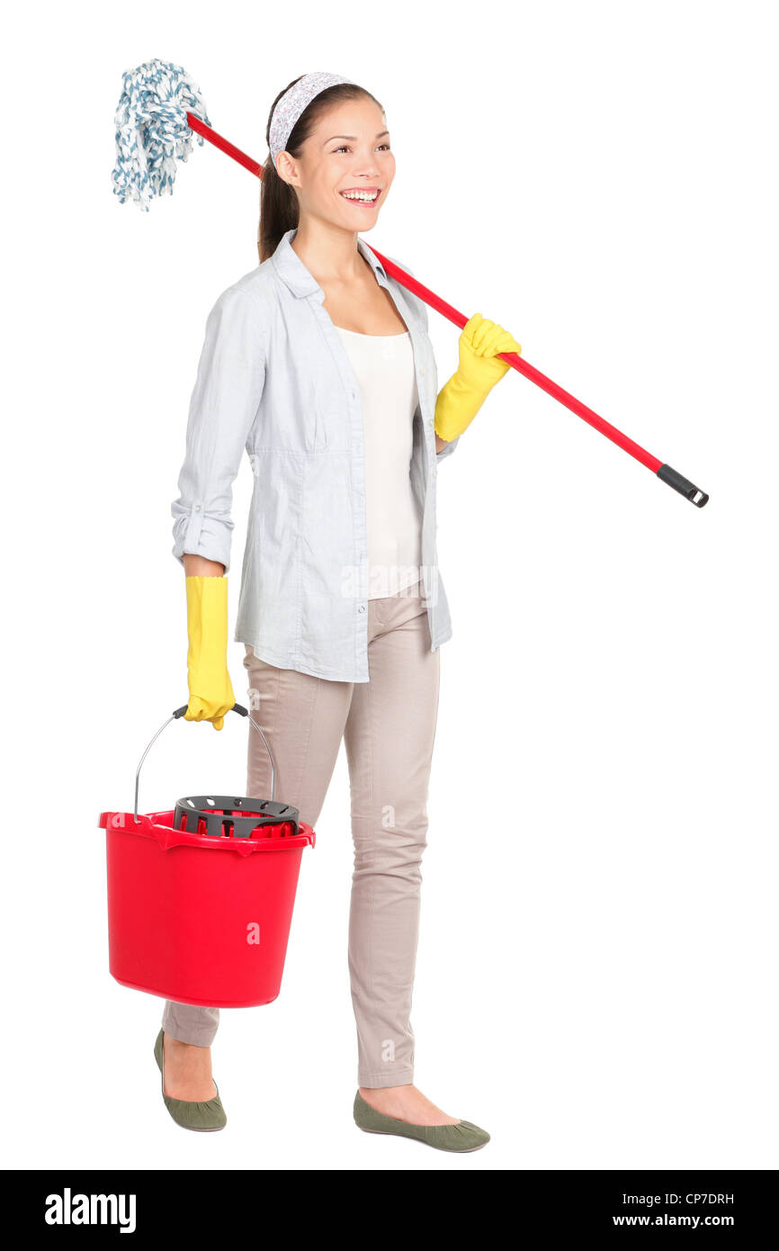 Full length of multiracial Chinese Asian / Caucasian housewife with mop and bucket walking isolated on white background - Stock Image