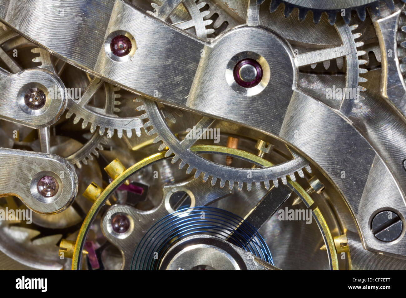 Antique pocket watch inside gears macro detail. - Stock Image