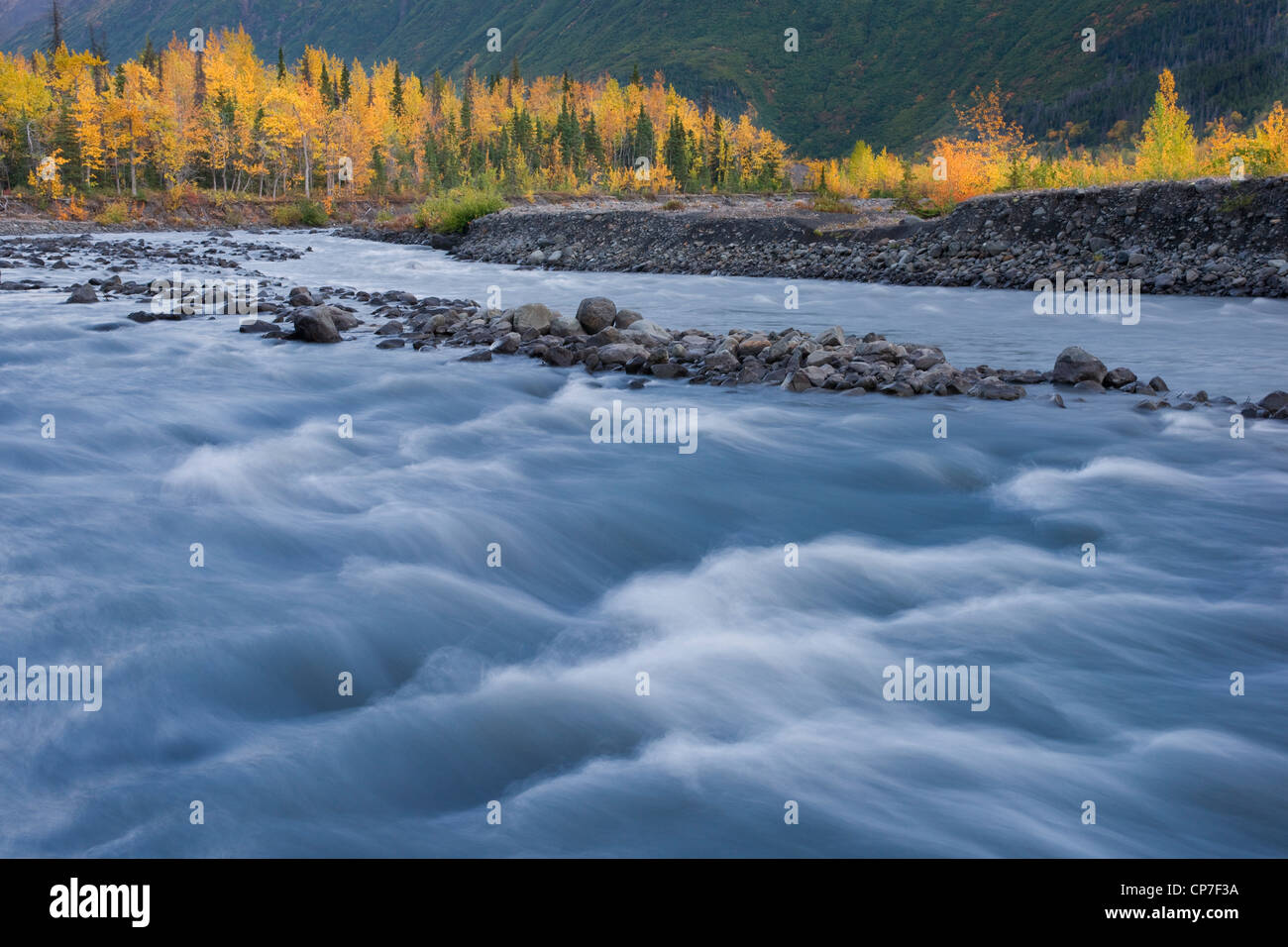Upper Eagle River and fall colors with Chugach Mountains in the background, Chugach State Park, Southcentral Alaska, - Stock Image