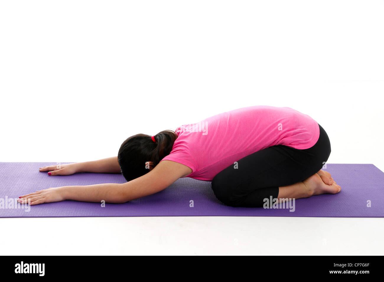 Girl Doing Yoga Pose in a Studio - Stock Image