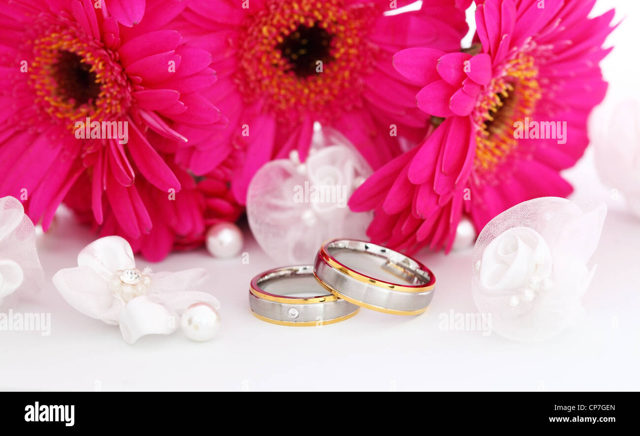 Wedding still life with beautiful golden rings and bouquet in Stock ...