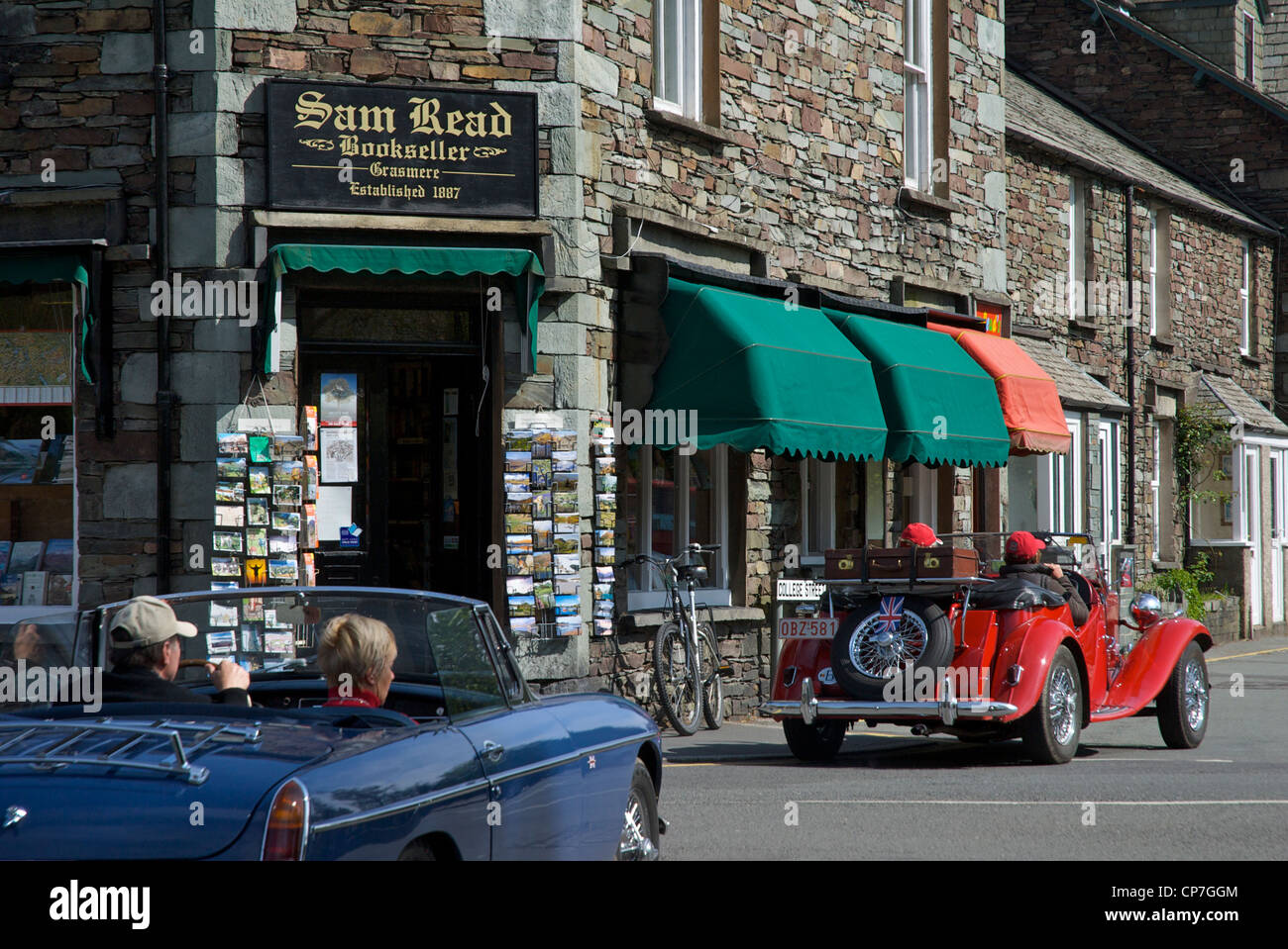 Two sports cars in the village of Grasmere, Lake District National Park, Cumbria, England UK - Stock Image
