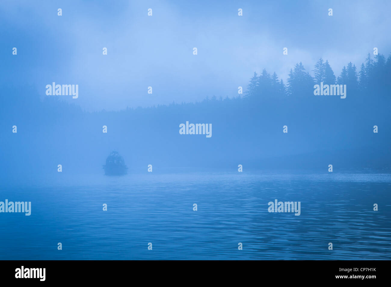 View of commercial fishing boat through thick fog, Bartlett Cove, Glacier Bay National Park & Preserve, Southeast - Stock Image
