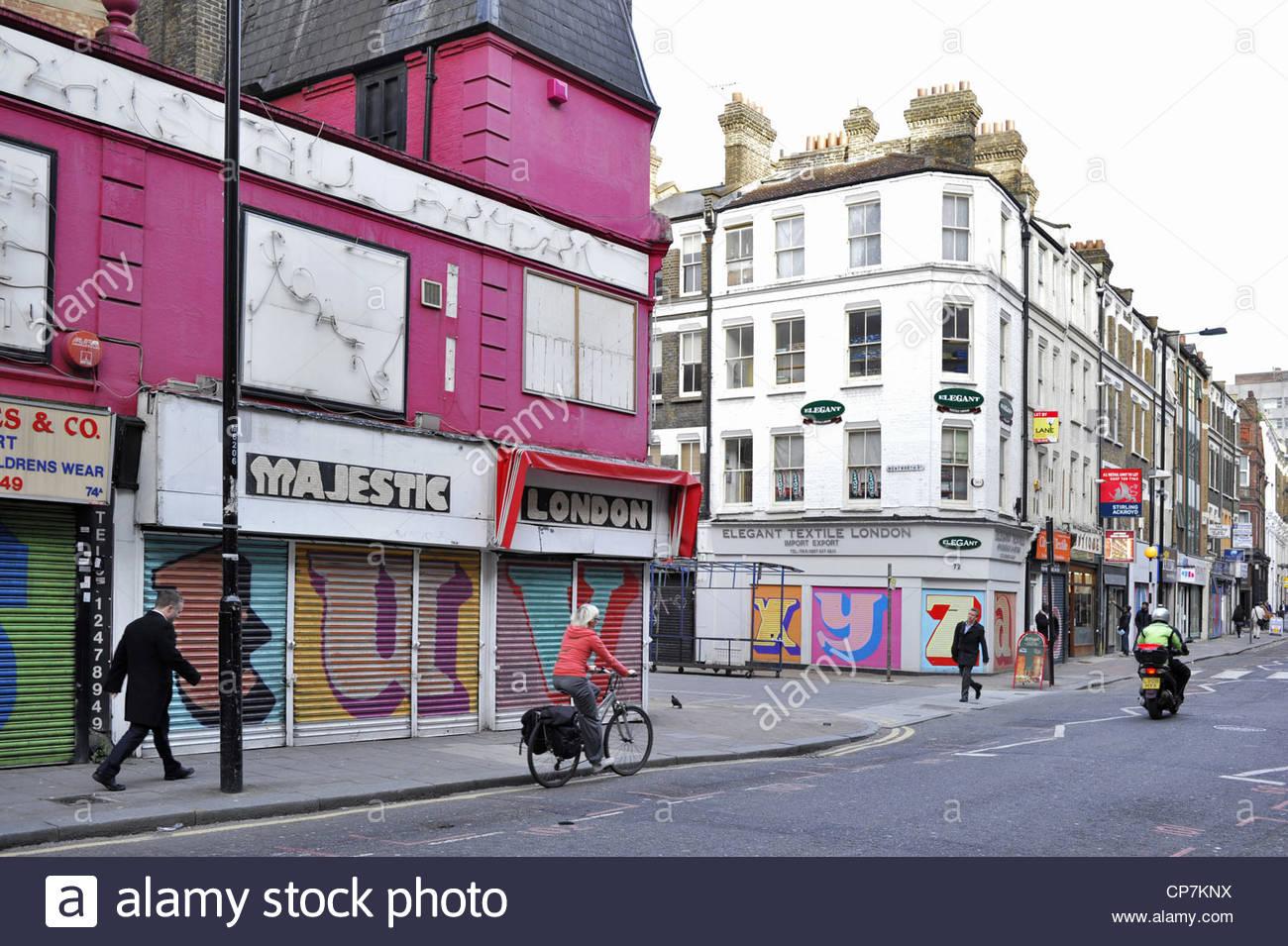 Street of Whitechapel with wall art of Ben Eine East London UK - Stock Image