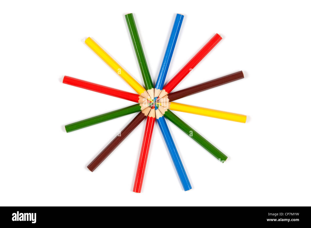 Many colored pencils arranged in circle over white background - Stock Image