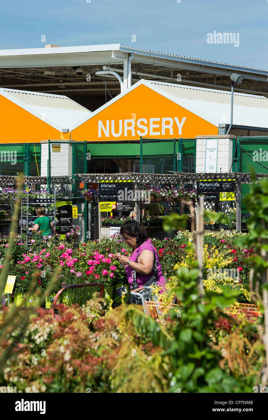 Shopping for plants at a nursery. - Stock Image