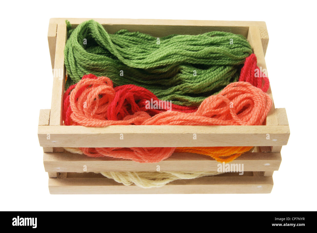 Yarn in Wooden Box on White Background - Stock Image