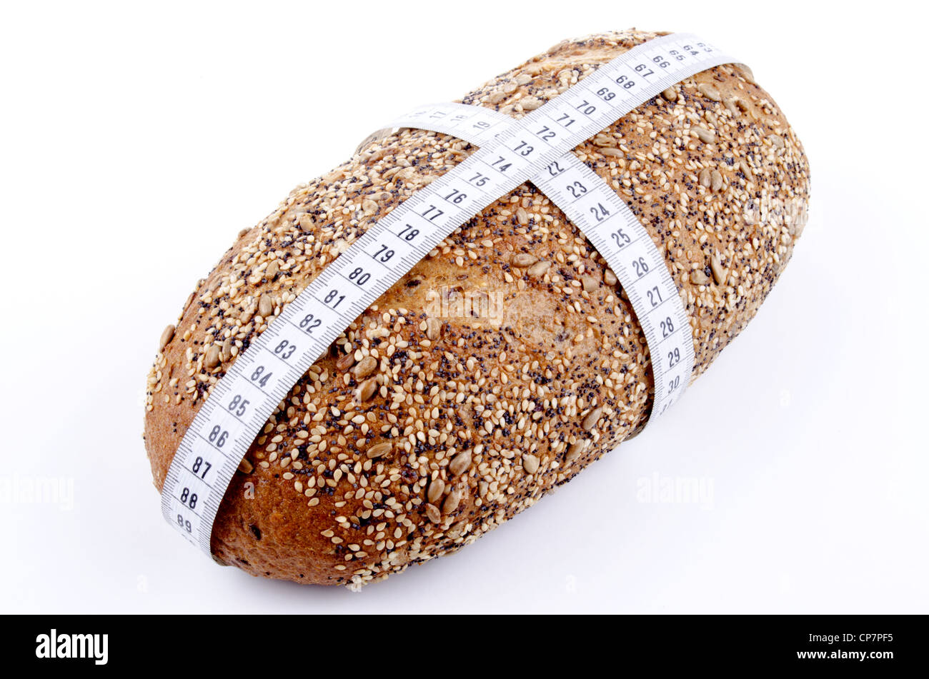 home baked multi grain bread with centimeter measuring tape - Stock Image