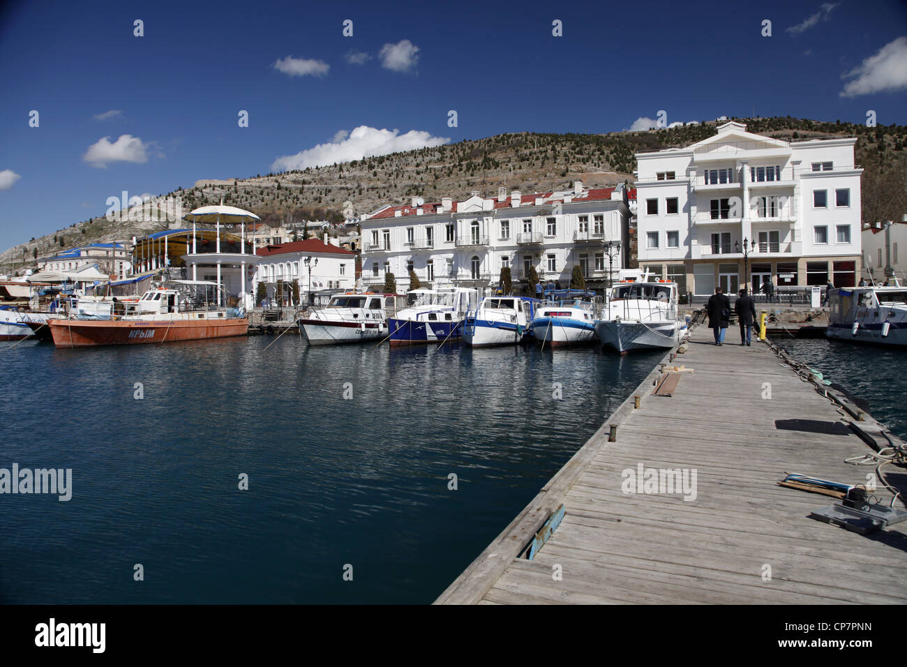 BOATS IN HARBOUR FROM JETTY BALAKLAVA CRIMEA UKRAINE 02 April 2012 - Stock Image