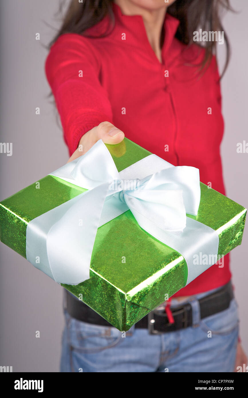 woman detail with a gift box in her hands - Stock Image