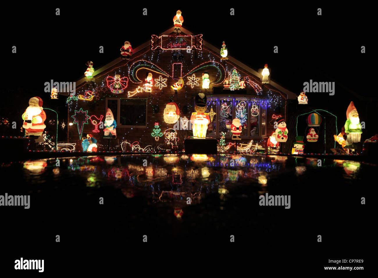 CHRISTMAS LIGHTS ON BUNGALOW RILLINGTON NORTH YORKSHIRE 30 December 2011 - Stock Image