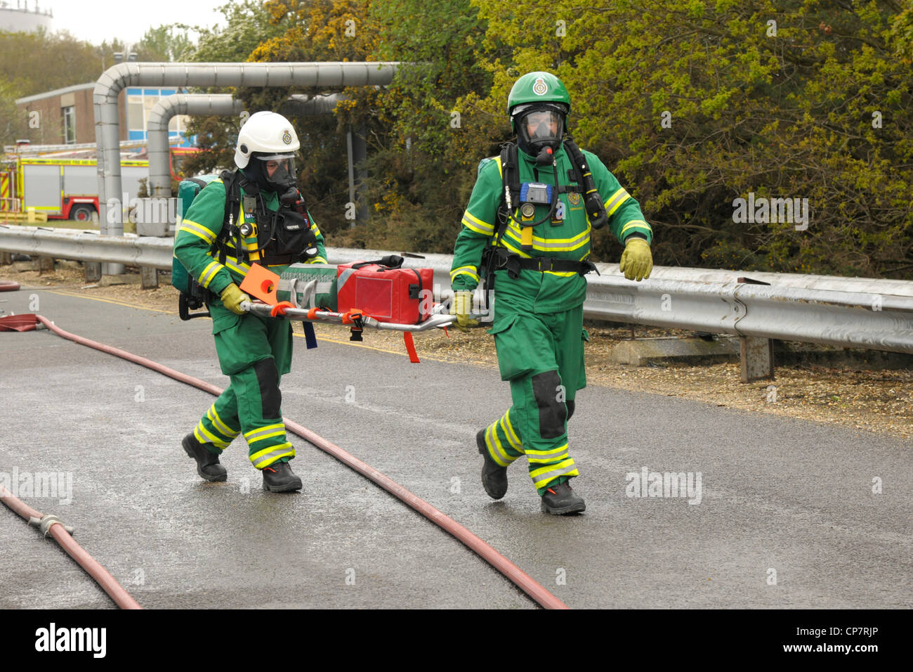 Paramedics carry a stretcher during a major incident exercise - Stock Image