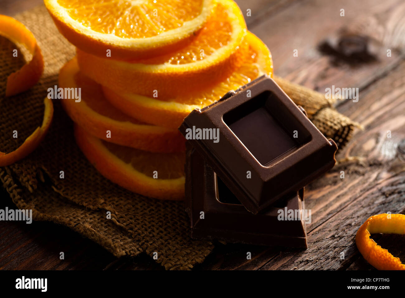 Chocolate Squares with Orange Slices on Jute and Wood - Stock Image