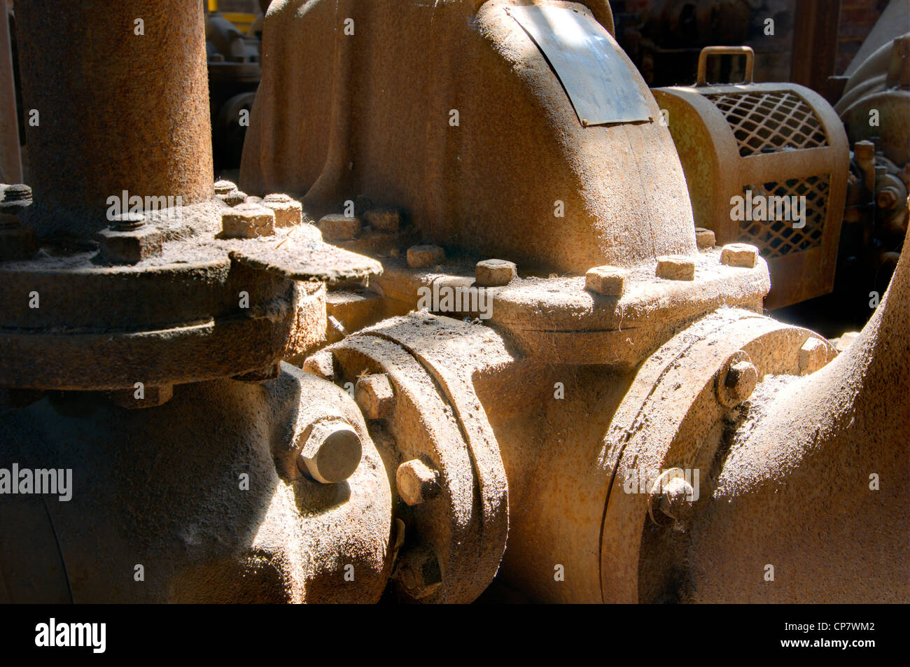 old machinery parts in a mill - Stock Image